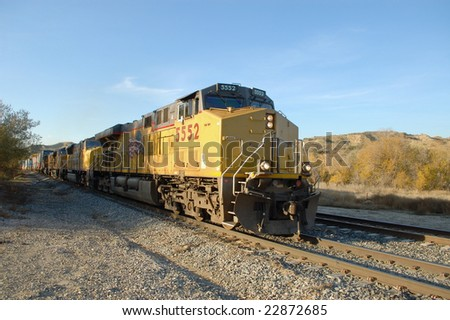 Diesel locomotives and freight train; San Timoteo Canyon; Redlands, California - stock photo