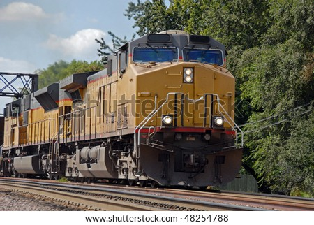 diesel train engine on tracks - stock photo