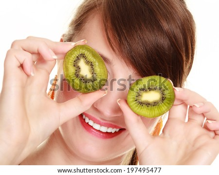 Diet and nutrition. Woman covering eyes with slices of kiwi citrus tropical fruit isolated on white. Girl doing fun. - stock photo