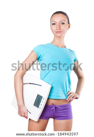 Diet and sport concept - young sporty woman with scale on white background  - stock photo