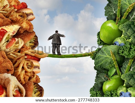 Diet change healthy lifestyle concept and having the courage to accept the challenge of losing weight as an overweight person on a high wire asparagus from fatty food towards vegetables and fruit. - stock photo