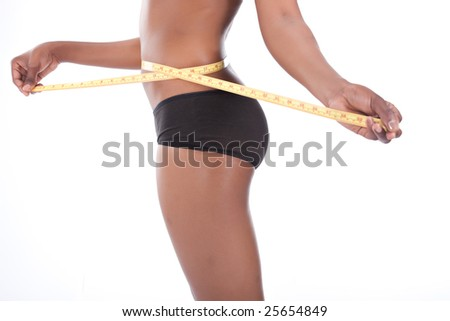 diet concept, african american  female, holding a tape measure - stock photo
