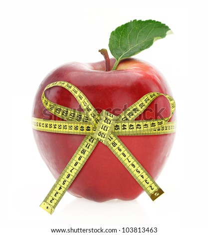Diet concept. Apple with measuring tape - stock photo