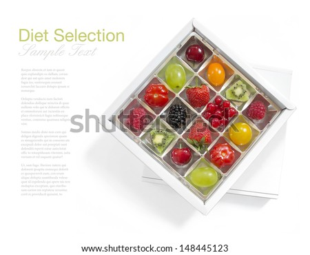 Diet concept - different fresh fruits in a chocolate box on white background, (manual focus) - stock photo