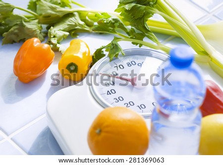 Diet concept. Fruits with measuring tape on a plate like weight scale - stock photo