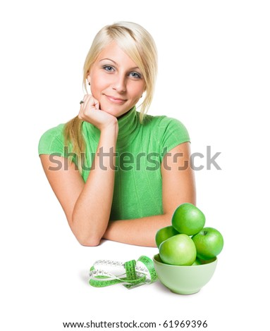Diet concept with gorgeous young blond girl and apples. - stock photo