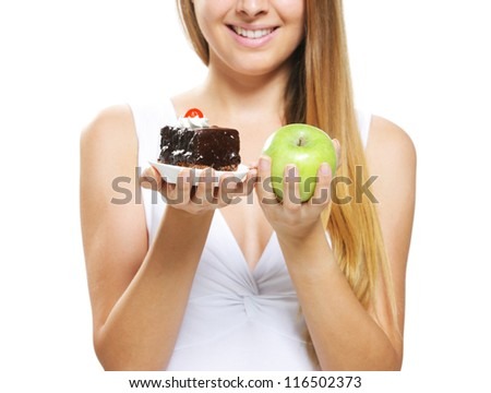 diet concept:  Woman choosing between fruits and cakes, isolated on white background - stock photo
