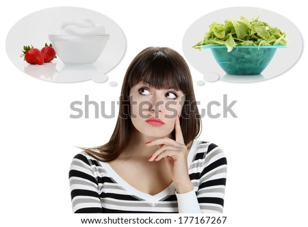 Diet. Dieting concept. Healthy Food. Beautiful Young Woman choosing between Fruits and Sweets. Weight Loss - stock photo