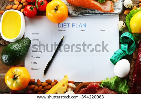 Diet food and diet plan on wooden background - stock photo