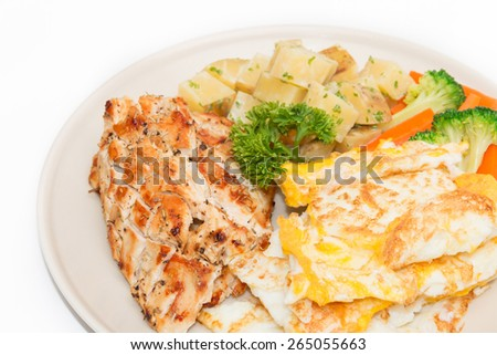 Diet food, Clean eating, Chicken steak and omelet with vegetable - stock photo