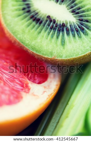 diet, food, healthy eating and objects concept - close up of ripe kiwi and grapefruit slices - stock photo