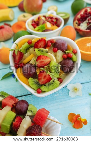 Diet, healthy fruit salad, fruit skewer - summer party - stock photo