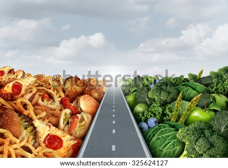 Diet lifestyle concept or nutrition decision symbol and food choices dilemma between healthy good fresh fruit and vegetables or greasy cholesterol rich fast food with a road or path between. - stock photo