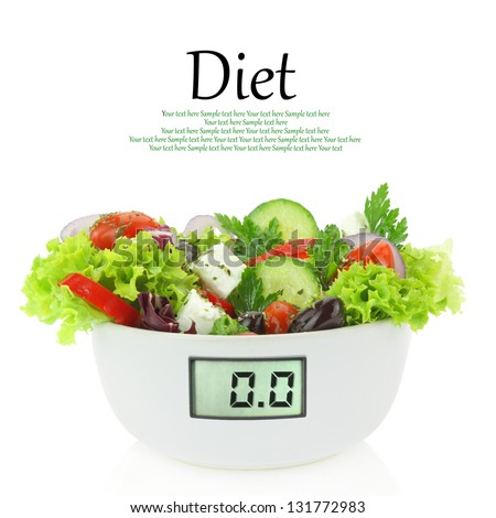 Diet meal. Vegetables salad in a bowl with digital weight scale - stock photo