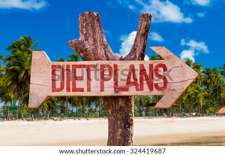 Diet Plans arrow with beach background - stock photo