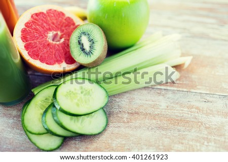 diet, vegetable food, healthy eating and objects concept - close up of ripe fruits and vegetables on table - stock photo