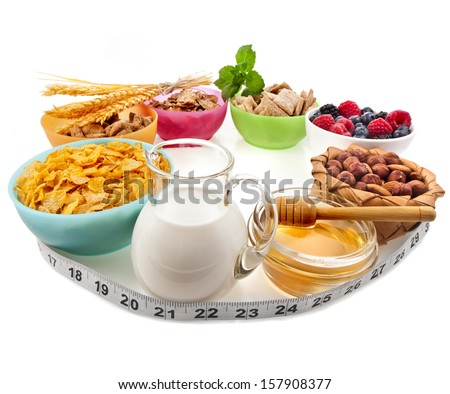 Diet weight loss breakfast concept with tape measure, isolated on a white background  - stock photo