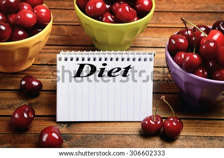 Diet word written on notepad - stock photo