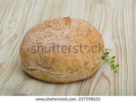 Dietary bread - with fresh thyme branch - stock photo