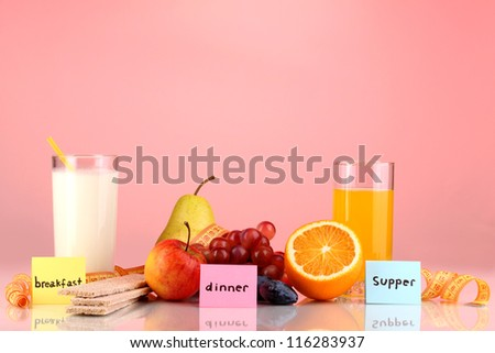 Dietary foods for breakfast, dinner and supper on red background - stock photo