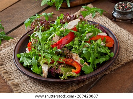 Dietary salad with chicken, arugula and sweet red pepper - stock photo
