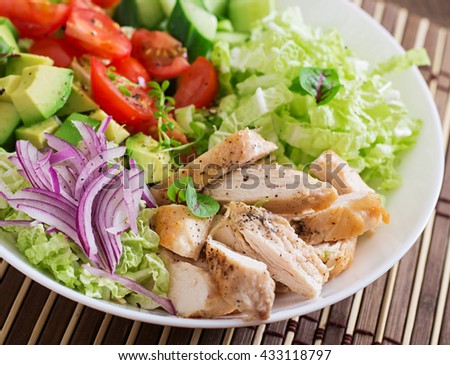 Dietary salad with chicken, avocado, cucumber, tomato and Chinese cabbage - stock photo