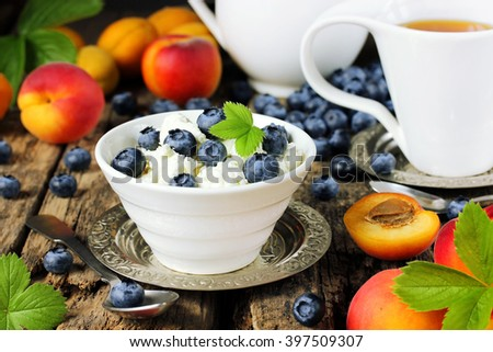 Dietary summer breakfast cottage cheese with fresh berries and fruits. Beautiful composition and concept of healthy food selective focus - stock photo
