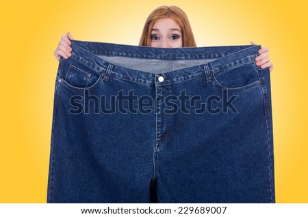Dieting concept with oversize jeans - stock photo