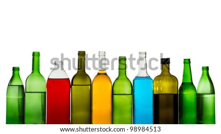 Different alcohol drinks bottles isolated on white - stock photo