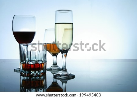 Different Alcoholic Drinks in glass and goblets Photo of different alcoholics drink in crystal glasses and goblets - stock photo