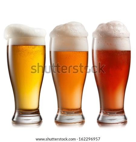 Different beer in glasses isolated on white background - stock photo