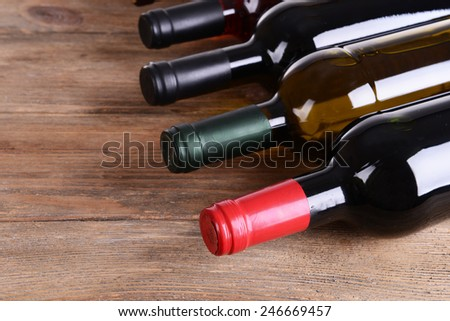 Different bottles of wine on table close-up - stock photo