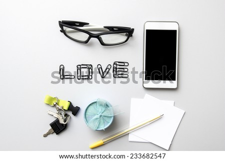 Different business objects on wooden desk. From above - stock photo