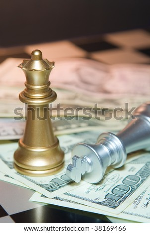 Different chessmen and money for a board - stock photo