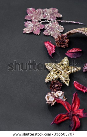 Different Christmas decorations on the dark background - stock photo