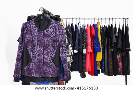 different clothes for females rack display-white background - stock photo
