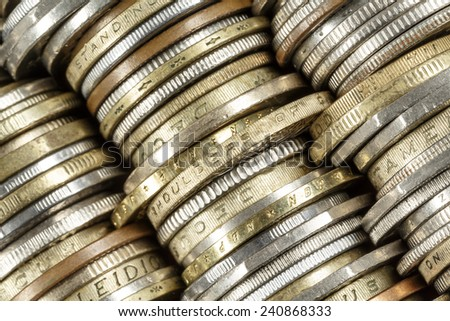 Different coins shown close up, forms the backdrop - stock photo