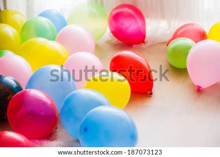 Different color balloons on the floor - stock photo