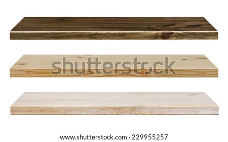 Different color wooden shelves isolated on white - stock photo