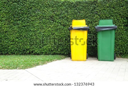 Different Colored Bins Green and yellow waste container - stock photo