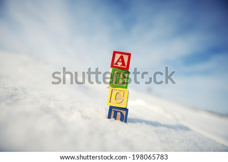 Different colored blocks with A, B, C and D on them. - stock photo