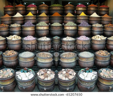 different colored herbs and spices in a moroccan street market - stock photo