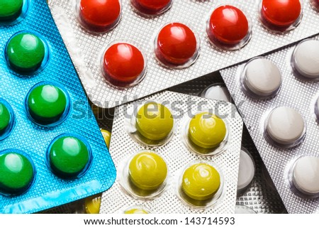 different colored pills in the pack closeup - stock photo