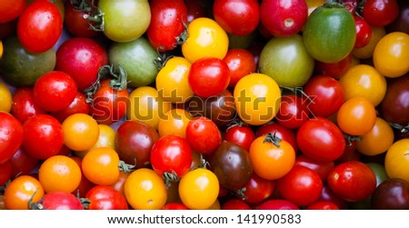 Different colorful cherry tomatoes at farmers market in Provence. - stock photo