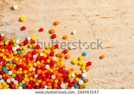 Different colorful sweets on the wooden table. - stock photo
