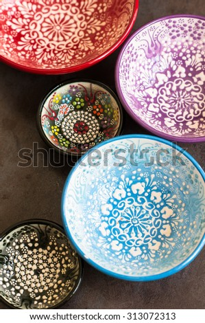 Different colors vintage eastern plates on the dark background - stock photo