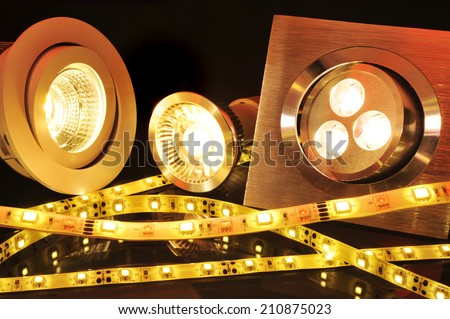 different current LEDs-technologies in orange spotlight  - stock photo