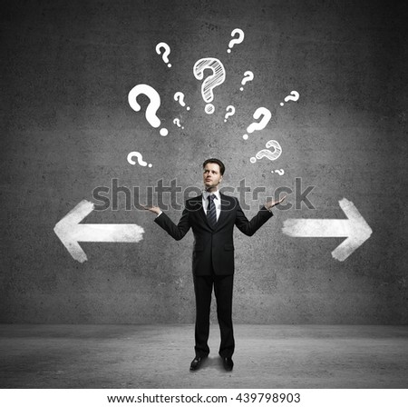 Different direction concept with confused businessman, question mark and arrow sketches on concrete background - stock photo