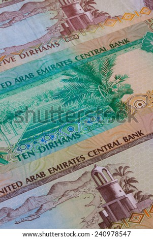 Different Dirham  banknotes from Emirates on the table - stock photo