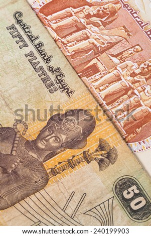 Different Egyptian  banknotes on the table - stock photo
